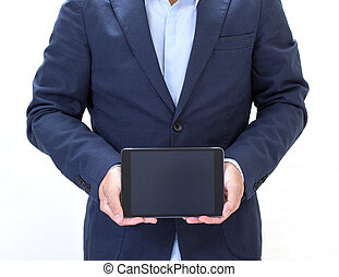 Businessman hand holding tablet computer