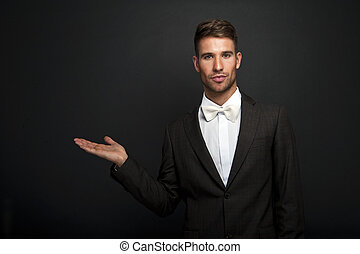 businessman hand holds somthing