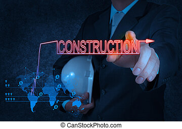 businessman hand pointing to construction