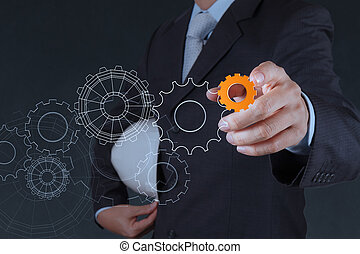 businessman hand pointing to gear to success