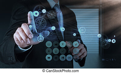 businessman hand pointing to the  gear to success