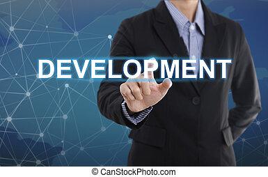 Businessman hand pressing button development. sign on virtual screen. business concept.