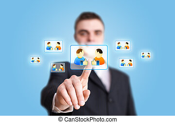 Businessman hand pressing Social network icon 2