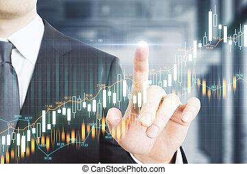 Businessman hand pushing glowing charts interface