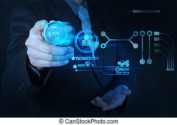 businessman hand pushing new technology button on modern computer as concept