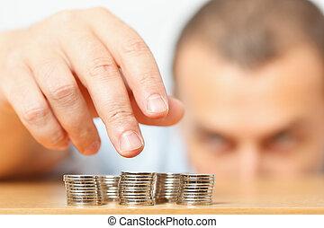 Businessman hand reaching for pennies - Businessman reaching...