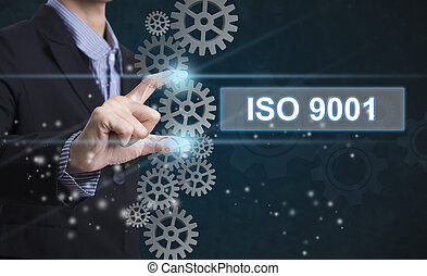 Businessman hand select wording iso 9001. sign on virtual...