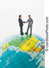 Businessman hand shaking on the global.