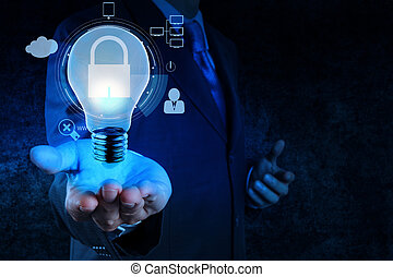 businessman hand show 3d light bulb icon with padlock as...