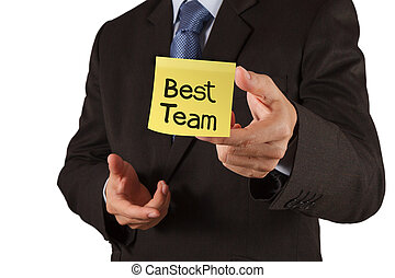 businessman hand show best team words on sticky note with white background as concept