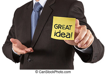 businessman hand show great idea words on sticky note with white background as concept