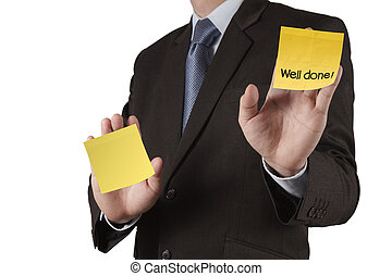 businessman hand show well done words on sticky note with white background as concept