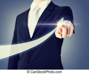 businessman hand showing arrow on virtual screen