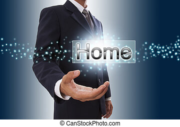 Businessman hand showing home button on virtual screen.