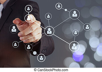 businessman hand showing human icon flow chart on new modern...