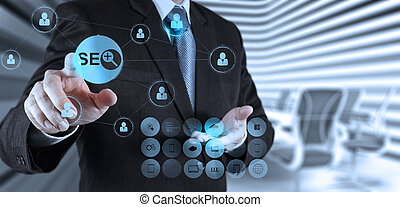 businessman hand showing search engine optimization SEO as...