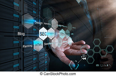 businessman hand showing search engine optimization as...