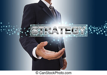 Businessman hand showing strategy button on virtual screen.