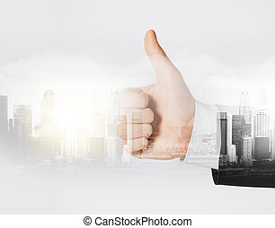 businessman hand showing thumbs up - business, gesture and...