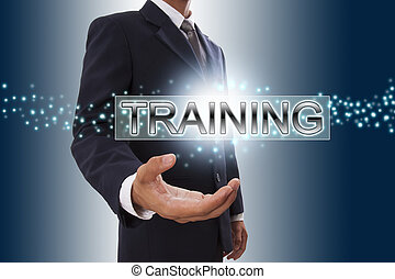 Businessman hand showing training button on virtual screen.