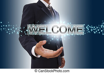 Businessman hand showing welcome button on virtual screen.