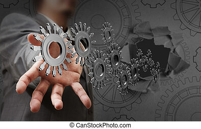 businessman hand shows people cogs