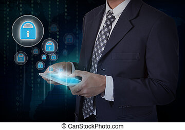 Businessman hand touch screen lock web security icon on a tablet.