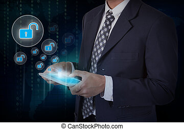 Businessman hand touch screen unlock icons on a tablet.