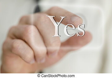 Businessman hand touching a Yes button