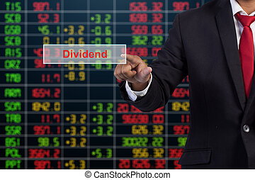 Businessman hand touching Dividend sign on virtual screen