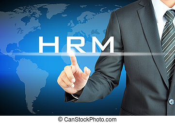 Businessman hand touching HRM (or Human Resources Management) sign on virtual screen