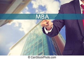 Businessman hand touching MBA (or Master of Business Administration) sign on virtual screen vintage color