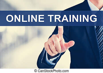 Businessman hand touching ONLINE TRAINING tab on virtual screen
