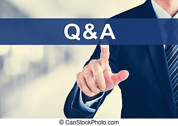 Businessman hand touching Q & A sign on virtual screen