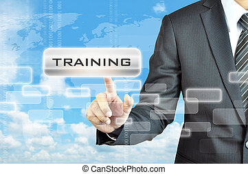 Businessman hand touching TRAINING sign on virtual screen