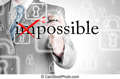 Businessman Hand turning the word Impossible into Possible with red marker