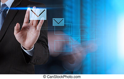 businessman hand use interactive computer with virtual email icon as concept