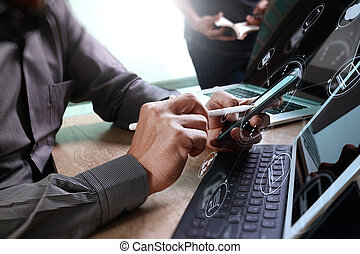 Businessman hand using mobile payments online shopping, omni channel, in modern office marble desk, icons graphic interface screen, eyeglass