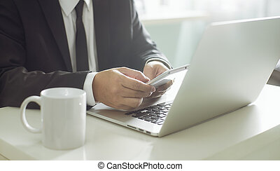businessman hand using smart phone,mobile payments online shopping.