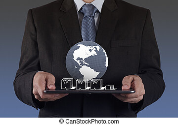 businessman hand using tablet computer and www.as internet concept