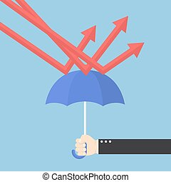 Businessman hand using umbrella to protect downtrend graph