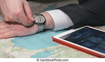 Businessman hand winds movement wrist watch - Businessman...