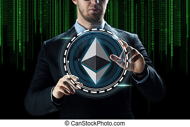 businessman hand with ethereum over binary code - ...