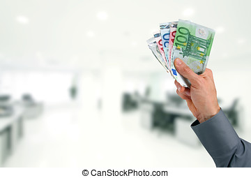 businessman hand with euro money at the office