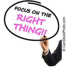 businessman hand with felt tip marker writing text focus on right thing