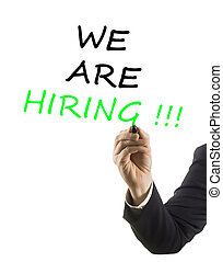 businessman hand with felt tip marker writing text we are hiring