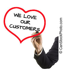 businessman hand with felt tip marker writing text we love ...