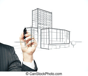 Businessman hand with pen drawing skyscraper