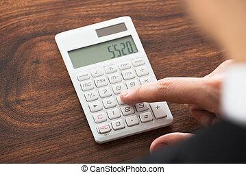 Businessman Hand Working On Calculator