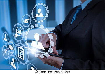 Businessman hand working with a digital tablet on meeting room
